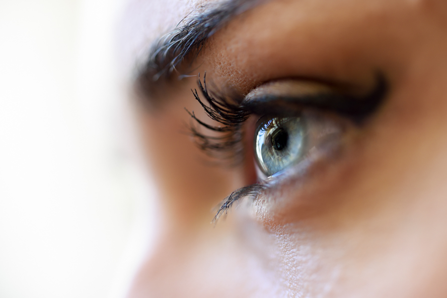 Close-up of young woman's blue eyes with long eyelashes. Make-eye