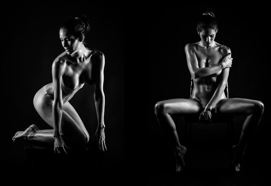 Young naked woman posing on black background. Perfect skin. Black and white photograph